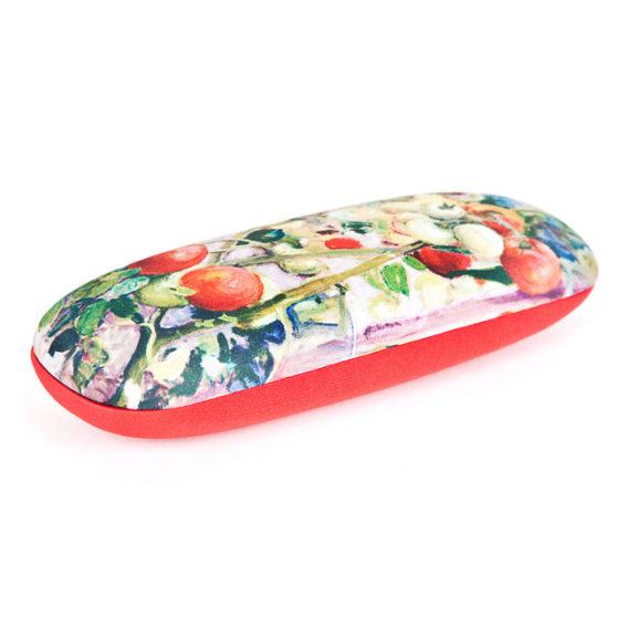 Tomaatteja silmälasikotelo, kannessa tomaatteja teoskuva, toinen puoli punainen