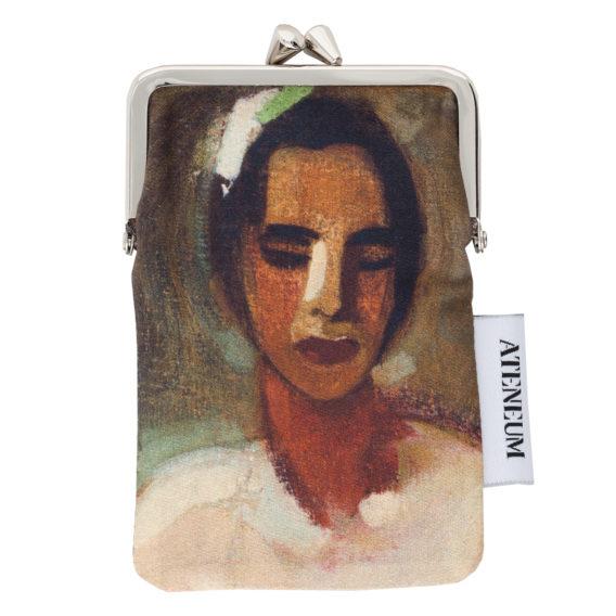 Kankainen kukkari metalliklipsulla, jossa naisen kasvot ruskean sävyillä maalattuna