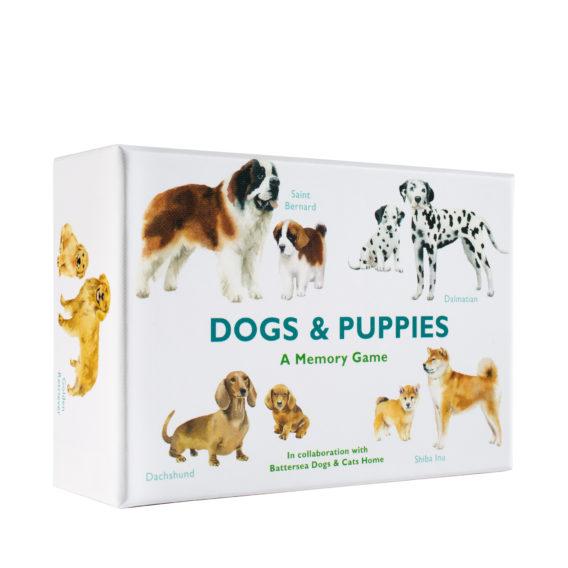 Valkoinen rasia, joka on kuvitettu erilaisilla koirilla ja niiden pennuilla