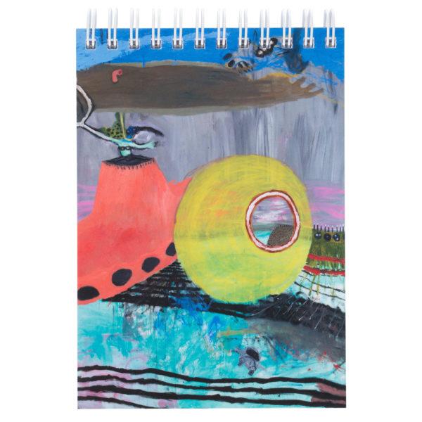 Kierrelehtiö, jonka kannessa värikkäitä muotoja