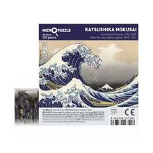 Kyljellään oleva putkilo, jonka kylkeen on kiinnitetty kuva, jossa vaaleanharmaalla taustalla iso aalto
