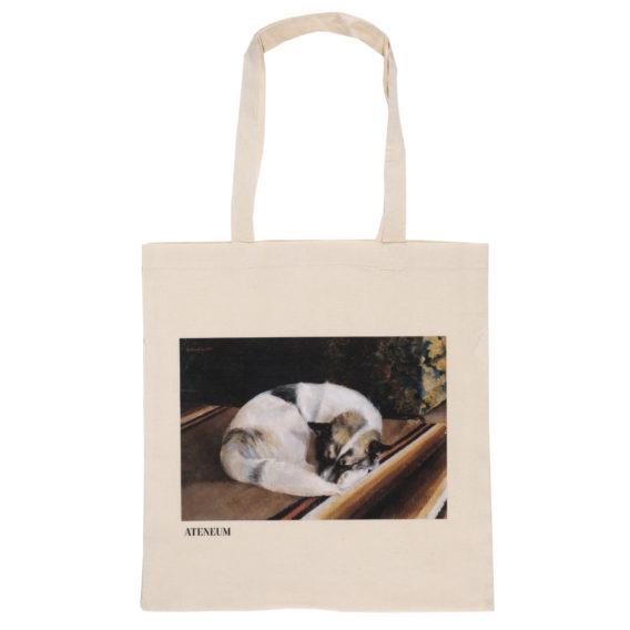 Vaalea kangaskassi, jossa matolla sykkyrässä makaava vaalea koira