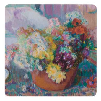 Lasinalunen, jossa värikkäitä kukkia punaisessa vaasissa