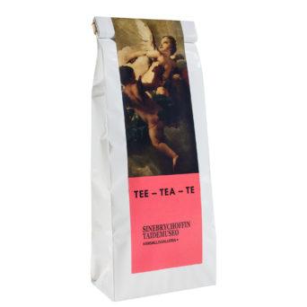 Valkoinen teepaketti, jossa taidekuva