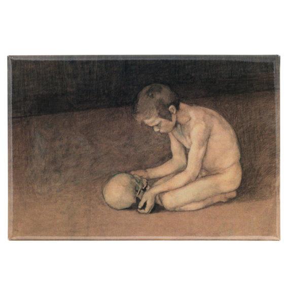 Magneetti, jossa polvillaan olevalla pojalla on käsissään pääkallo