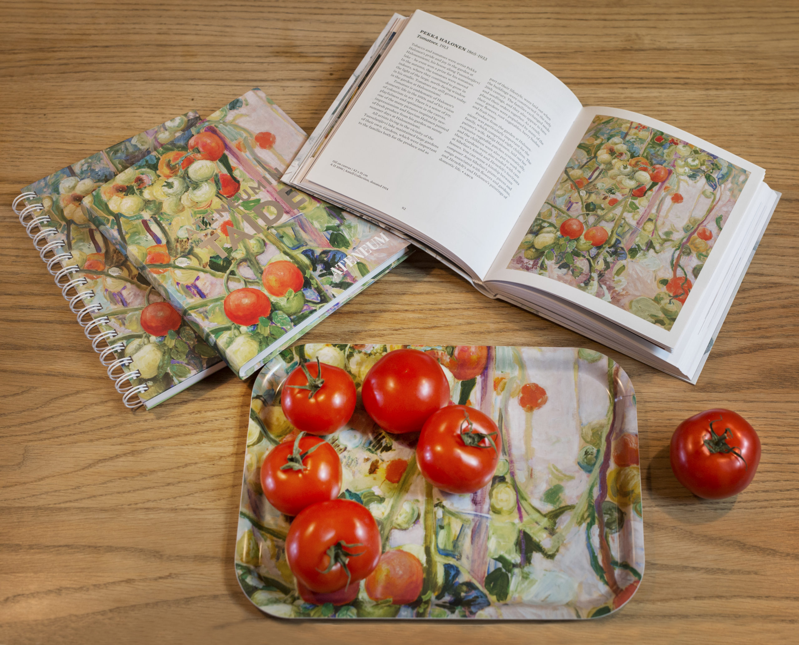 Tomatoes and museum shop products on the wooden table