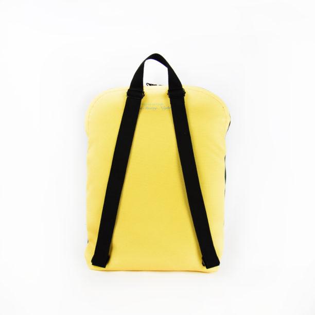 Repun selkäpuoli, keltainen kangas ja mustat olkaimet