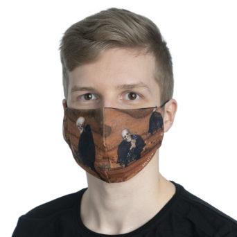 Vaalean pojan kasvoilla kankainen kuviollinen maski