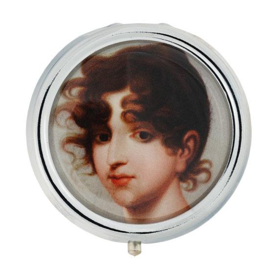 Pyöreä rasia, jonka kannessa naisen kasvot