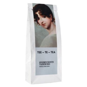 Valkoinen teepaketti, jossa kuva naisen kasvoista