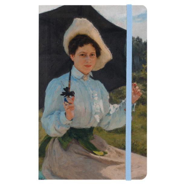 Vihkon kannessa nainen aurinkovarjon kanssa