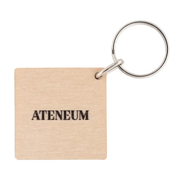 Puisen neliönmallisen avaimenperän takapuoli jossa musta logo