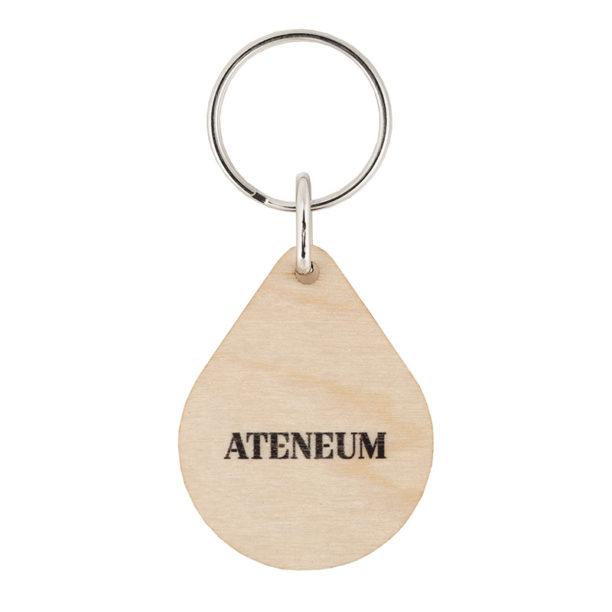 Puisen avaimenperän takapuoli jossa musta Ateneumin logo